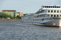 White cruise ship. RUSSIA, SAINT PETERSBURG - AUGUST 18, 2017: Berth Utkina Zavod. White cruise ships moored to the pier Royalty Free Stock Photography