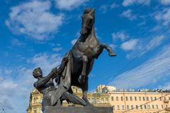 The Horse Tamers. RUSSIA, SAINT PETERSBURG - AUGUST 18, 2017: Famous sculpture `The Horse Tamers` on Anichkov Bridge across the Fontanka River, designed by the Royalty Free Stock Photography