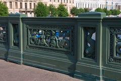 Fragment of cast-iron fence. RUSSIA, SAINT PETERSBURG - AUGUST 18, 2017: Fragment of cast-iron fence with the Sea horses on Anichkov Bridge. City walks Saint Royalty Free Stock Photography