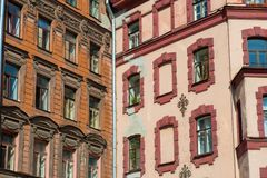 Fragment of an old building facade. RUSSIA, SAINT PETERSBURG - AUGUST 18, 2017: Fragment of an old building facade with ornate decoration in the center of St Stock Photography