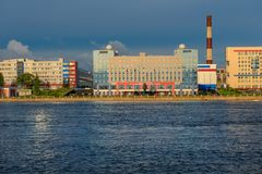 Office buildings on the banks of the Neva. RUSSIA, SAINT PETERSBURG - AUGUST 18, 2017: Industrial building and area of concern VKO `Almaz-Antey` North West royalty free stock photo