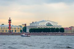 Landmarks of Vasilievsky island spit - rostral column and old stock exchange building stock photography
