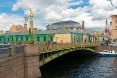 Panteleymonovsky Bridge. RUSSIA, SAINT PETERSBURG - AUGUST 18, 2017: Panteleymonovsky Bridge, on the background of the embankment of the Fontanka River, Pestel Royalty Free Stock Photography