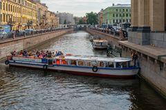 Pleasure boat makes a maneuver. RUSSIA, SAINT PETERSBURG - AUGUST 18, 2017:A pleasure boat makes a maneuver on the Griboedov Canal in Saint Petersburg Stock Image