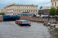 Moika River. RUSSIA, SAINT PETERSBURG - AUGUST 18, 2017: Pleasure boat sails on the Moika River near the near the Blue Bridge Royalty Free Stock Photo