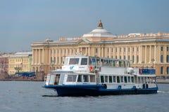 Pleasure excursion boat. RUSSIA, SAINT PETERSBURG - AUGUST 18, 2017: Pleasure excursion boat with tourists walking along the Neva River Stock Images