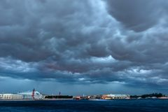 Storm clouds. RUSSIA, SAINT PETERSBURG - AUGUST 18, 2017: Storm clouds in Saint Petersburg. The Palace bridge. Vasilievsky island stock photos