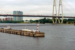 Neva river, near the Vantovoy bridge. RUSSIA, SAINT PETERSBURG - AUGUST 18, 2017: Utkina wharf and the salt pier on the Neva river, near the Vantovoy bridge Royalty Free Stock Photo