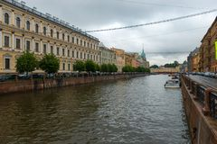 Moika river. RUSSIA, SAINT PETERSBURG - AUGUST 18, 2017:  View of Moika river embankment on a rainy summer day Royalty Free Stock Image
