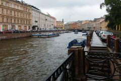 View of Moika river. RUSSIA, SAINT PETERSBURG - AUGUST 18, 2017:  View of Moika river embankment on a rainy summer day Stock Image