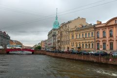 View of Moika river embankment. RUSSIA, SAINT PETERSBURG - AUGUST 18, 2017:  View of Moika river embankment on a rainy summer day Royalty Free Stock Image