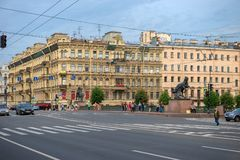 View of the Nevsky Prospekt and Anichkov Bridge. RUSSIA, SAINT PETERSBURG - AUGUST 18, 2017: View of the Nevsky Prospekt and Anichkov Bridge on a summer day Royalty Free Stock Image