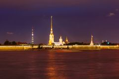 Peter and Paul Fortress. RUSSIA, SAINT PETERSBURG - AUGUST 18, 2017: View on the Peter and Paul Fortress, the river Neva, the steeple with a cross on a dark Stock Photos
