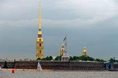 View on the Peter and Paul Fortress. RUSSIA, SAINT PETERSBURG - AUGUST 18, 2017: View on the Peter and Paul Fortress, the river Neva, the steeple with a cross Stock Photo