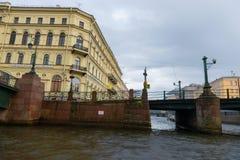 View from the water at Matveyev Bridge. RUSSIA, SAINT PETERSBURG - AUGUST 18, 2017: View from the water at Matveyev Bridge and the embankment of the Kryukov Royalty Free Stock Photo