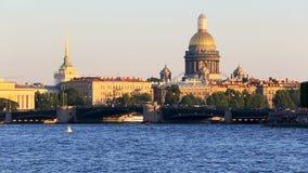 Admirality spire, trafffic on Palace Bridge, Saint Isaaks Cathedral, riverside. Russia, Saint-Petersburg, 2 JULY 2016: pleasure transport on Neva, Palace Bridge stock video