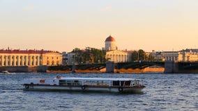 Birzhevoj Exchange bridge.Literary Museum of the Institute of Russian Literature. Russia, Saint-Petersburg, 2 JULY 2016: pleasure transport on Neva, Vasilievskiy stock video