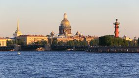 Admirality spire, Rostral Columns, Palace Bridge, Saint Isaaks Cathedral. Russia, Saint-Petersburg, 2 JULY 2016: pleasure transport on Neva, Vasilievskiy Island stock footage