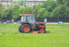 Russia Saint Petersburg July 2016 tractor mows the grass stock photography