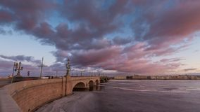 Russia, Saint-Petersburg, 19 March 2016: Pink clouds over the Troitsky bridge stock video footage