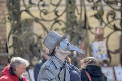 Man in image of devil or Cyrano de Bergerac. Royalty Free Stock Photo
