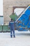 Russia, Saint-Petersburg, Nikolsky February 9, 2017-the worker empties garbage barrels garbage Stock Photo