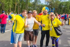 Beautiful football fans from Russia and Sweden communicate with each other before the match England Sweden at the World Cup. Russia, Samara, July 2018: beautiful stock photo