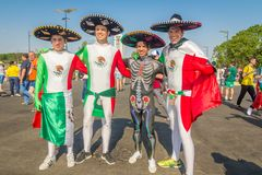 Beautiful Mexican fans in national clothes before the match Brazil Mexico for the World Cup. Russia, Samara, July 2018: beautiful Mexican fans in national stock photos