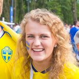 Football fan from Sweden with a painted face in national colors before the match England Sweden at the World Cup stock image