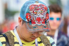 Ootball fan with baseball cap with embroidered tiger