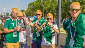 A group of Mexican football fans celebrating the World Cup. Russia, Samara, June 2018: a group of Mexican football fans celebrating the World Cup royalty free stock photo