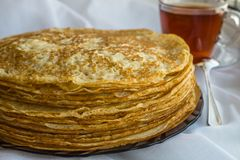 Russia, Severodvinsk, a stack of homemade Russian pancakes, close-up. The Concept of a Holiday Maslenitsa.  stock photos