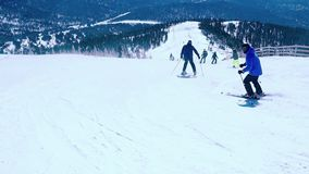 Russia, Sheregesh, 26 march 2015, Skiing, mountains and skiers in slowmotion. Ski vacation. 1920x1080. Skiing, mountains and skiers in slowmotion. Ski vacation stock video