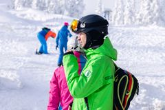 Russia, Sheregesh 2018.11.78 Professional snowboarder in bright royalty free stock image