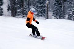 Russia, Shoriya 2018.11.18 Professional snowboarder in bright sp stock photo