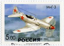 RUSSIA - 2005: shows The Mikoyan-Gurevich MiG-3, series OKB planes by A.I.Mikoyan, the aircraft designer. RUSSIA - CIRCA 2005: A stamp printed in Russia shows stock photography