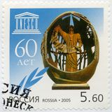 RUSSIA - 2005: shows The sculpture called The birth of a New Man by Z.Tsereteli, dedicated to the 60th anniversary of UNESCO. RUSSIA - CIRCA 2005: A stamp royalty free stock images