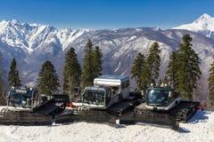 RUSSIA, SOCHI, GORKY GOROD - MARCH 29, 2017: Snowcat machines on slopes of Gorky Gorod ski resort royalty free stock photography
