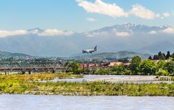 The plane lands at the airport of Sochi royalty free stock image