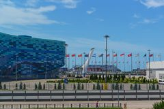 Square in the Olympic Park with festive flags of different countries. Adler, summer Sunny day Stock Images