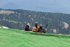 RUSSIA, SOCHI - MAY 25, 2018: Editorial photo on top of rose Peak, Rosa Khutor. The instructor and two paraglider stock images