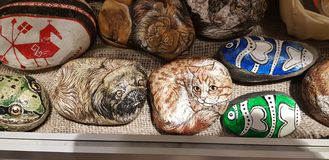 Souvenirs - drawings of animals on stones. Russia, Sortavala, 03,01,2019 Souvenirs - drawings of animals on stones stock images