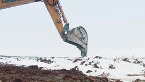RUSSIA ST.PETERBURG- 28 FEBRUARY: Excavator is digging the ground stock video footage