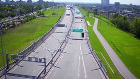 RUSSIA ST.PETERBURG- 28 MAY 2016: Aerial view of modern highway interchange near city on a sunny summer day stock video footage