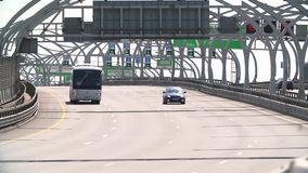 RUSSIA ST.PETERBURG- 28 MAY 2016: Car Traffic on Modern Highway on a hot day. the Action in Real Time. RUSSIA ST.PETERBURG- 28 MAY 2016: Car Traffic on Highway stock video footage