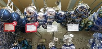Blue Christmas balls in the store on sale stock photography