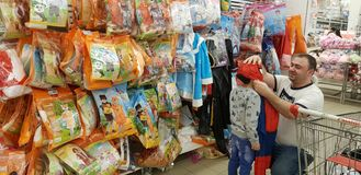 Buyers choose the costume of the spiderman child for the New Yea. Russia, St. Petersburg 06.12,2018 Buyers choose the costume of the spiderman child for the New stock photo