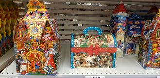 Christmas gift wrapping with sweets in the supermarket stock photos