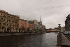 Russia, St. Petersburg, Embankment of the Moika River. Under the leaden clouds Stock Photos