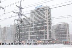 Russia St. Petersburg - February - 2019: winter, Murino district at rush hour people walk on the Devyatkino metro. Heavy royalty free stock images